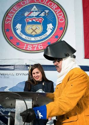 Annie Mabus chalked her initials into the keel of the nuclear submarine Colorado, which were then welded by Electric Boat employee John Alves (Photo courtesy of General Dynamics)