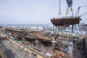 John F. Kennedy's lower stern was lifted into place at the company's Newport News Shipbuilding division, where the second Gerald R. Ford-class aircraft carrier is now 50 percent structurally complete. (Photo: John Whalen/HII)