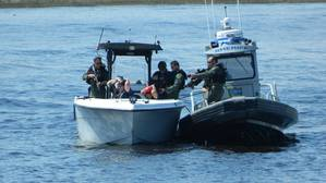 One of the MARSEC East 205 boat demonstrations featured a pursuit and arrest of noncompliant boaters in an exclusion area.  (Photo by William Lusk)