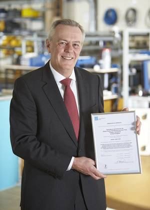 John Ramsden, Managing Director for Sonardyne, with Sonardyne Ltd.'s OHSAS 18001 certification