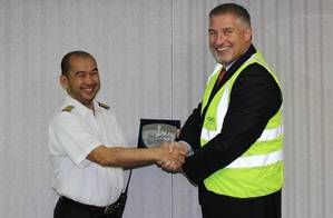 Capt. Guillermo Endozo (left) accepting a commemorative plaque from Gary Lemke, EVP Ports, Abu Dhabi Ports