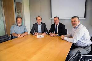 Port Taranaki representatives and Sanmar's sales director at the contract signing: Grant Squire, marine engineer supervisor; Guy Roper, chief executive; Craig Bramley, Sanmar director of sales-Australian region; and Neville Fox, head of marine services (Photo: Sanmar)