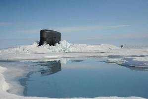 The fast attack submarine USS Seawolf surfaces through Arctic ice at the North Pole. (U.S. Navy photo)