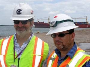 Crowleys Bleu Hilburn and Tony Ortiz in front of the companys chartered ship Vega (Photo courtesy of Crowley Maritime Corp.)