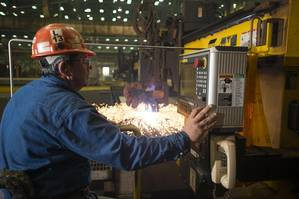 Paul Bosarge, a burner specialist workleaderman at Ingalls Shipbuilding, initiates a cut of steel on the National Security Cutter Kimball (WMSL 756) using the Avenger 3 Plasma cutter (Photo by Andrew Young/HII)