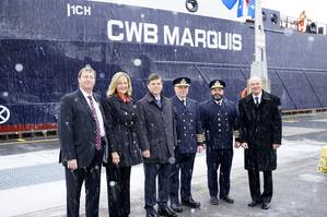 (L to R) Lafarge Purchasing Manager for Eastern Canada Ken Lerner, U.S. Saint Lawrence Seaway Development Corporation Administrator Betty Sutton, Saint Lawrence Seaway Management Corporation CEO Terence Bowles, Chief Engineer David Michalowicz, Captain Seann ODonoughue, and CWB CEO Ian White in front of the CWB Marquis, April 2.