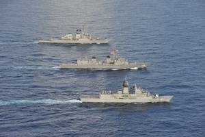 Arleigh Burke-class guided-missile destroyer USS John S. McCain (DDG 56) joined the Royal Australian Navy (RAN) and Japan Maritime Self Defense Force (JMSDF) in the South China Sea for multinational exercises, Oct. 19. (Photo: U.S. Navy)