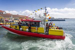 A 14-meter launch placed into service last year by the Swedish Sea Rescue Society has parallel diesel and electric drives consisting of twin 650 hp diesels with waterjets and dual Torqeedo Deep Blue 50 kW electric motors with 10 kWh Deep Blue lithium batteries. (Photo: Torqeedo)