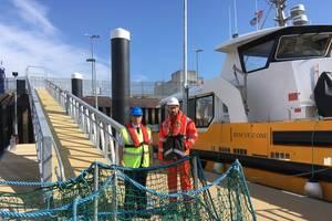 Captain Jeff Gaskin, Aberdeen Harbour Master, and Adam Ezzamel, EOWDC Project Director, Vattenfall, on the new pontoon Photo Aberdeen Harbor )