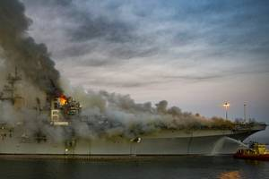 Flames and thick, dark smoke rise from the USS Bonhomme Richard (LHD 6) at Naval Base San Diego, July 12.  (U.S. Navy Photo by Austin Haist)