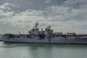 The fire-stricken amphibious assault ship USS Bonhomme Richard (LHD 6) sits pier side at Naval Base San Diego in July 2020. (Photo: Jason Waite / U.S. Navy)