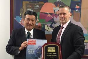 "Mr. Yoshikazu Kawagoe, Chief Technical Officer, Mitsui O.S.K. Lines accepts the ""Great Ship of 2017"" Award from Greg Trauthwein, Maritime Reporter & Engineering News."