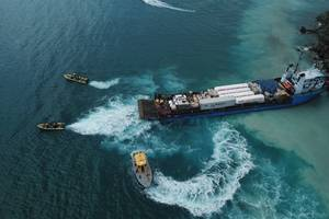 Sea Tow Virgin Islands works to un-ground a 223-foot cargo ship that grounded while taking supplies to hurricane ravaged Puerto Rico (Photo: Sea Tow Virgin Islands)