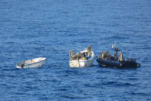 Six suspected pirates and their vessels were detained following reported attacks on a containership and a fishing vessel off Somalia (Photo: EU NAVFOR Somalia)