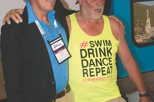 """The attendees were delighted with the good-humored sparring of two Australian heavy weights of the ferry world: Austal's Mike Wake and Incat's Bob Clifford. Clifford, an icon of the industry and dressed in casual Aussie attire, made the case for the efficiency of """"two long skinny hulls"""" while Wake, with an impressive video, argued for the sea kindliness of a third central hull. (Photo: Alan Haig-Brown)"""