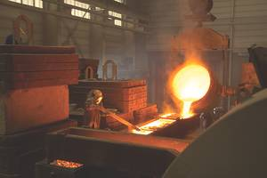 The mold is 1,100 degree Celsius liquid bronze is flowing into the prepared propeller mould.to be filled.
