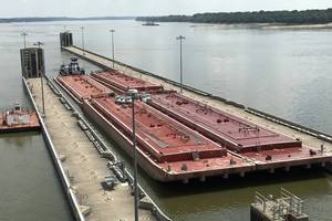 The M/V Steve Golding transits  through the Olmsted Locks in late July. Called by some stakeholders, 'the Manhatten Project' of civil engineering, Olmsted is finally completed at an enormous cost. (CREDIT: USACE)