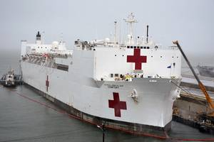 USNS Comfort (T-AH 20) takes on fuel and supplies at Naval Station Norfolk, Va. in preparation to deploy to New York in support of the nation's COVID-19 response efforts and will serve as a referral hospital for non-COVID-19 patients currently admitted to shore-based hospitals. (U.S. Navy photo by Jim Kohler)