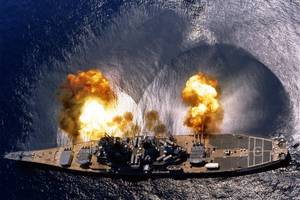 USS Iowa (BB-61) Fires a full broadside of nine 16/50 and six 5/38 guns during a target exercise near Vieques Island, Puerto Rico, 1 July 1984. Photographed by PHAN J. Alan Elliott. Note concussion effects on the water surface, and 16-inch gun barrels in varying degrees of recoil. Official U.S. Navy Photograph, from the the Department of Defense Still Media Collection.