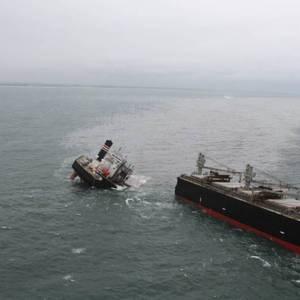 Bow Section of Broken Up Ship Crimson Polaris Towed to Shore