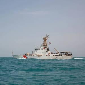 US Coast Guard Fires Warning Shots in Swarm of Iranian Vessels
