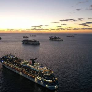 Carnival Cruise Ships Rendezvous to Repatriate Crew Members
