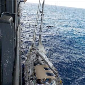 Containership Tows Disabled Sailboat to Safety