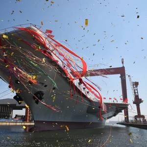 China Launches First Home-built Aircraft Carrier