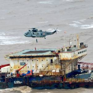 Indian Rescuers Searching for 26 Still Missing from Sunken Barge