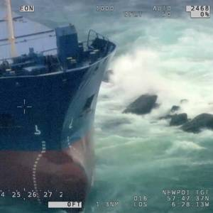 Salvors Working to Refloat Cargo Ship Aground in the UK