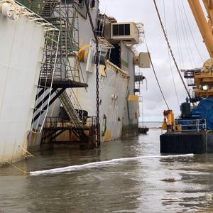 Salvors Separate Stern Section from Capsized RoRo Golden Ray