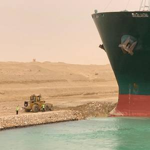 Container Ship Runs Aground Blocking Suez Canal Traffic
