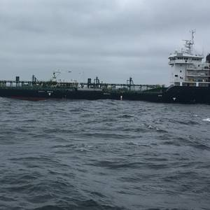 Fire Stricken Tanker Towed to New York