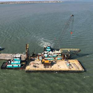 Dredge Barge Taking on Water Pushed Aground