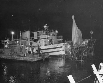 File U.S. Navy tugs and diving barge alongside USS Guitarro (SSN-665) May 15, 1969 (U.S. Navy photo)