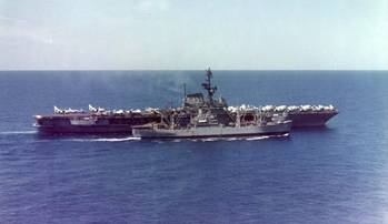 File Paricutin (AE-18) rearming Coral Sea (CVA-43). U.S. Navy photo.