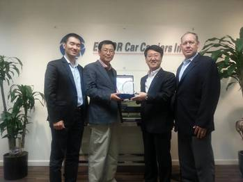 File Capt. S.C. Kim, ISS Port Captain for Korean Customers, receiving the award for 'Best in Vessel Operation' from Mr. Sang Kim, Director of EUKOR and Head of EUKOR America.