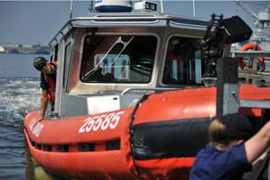 File A crew from Coast Guard Station Curtis Bay, Md., trailers a 25-foot Response Boat-Small from the water to ensure its safety until the effects of Hurricane Earl are over in the upper Chesapeake Bay, Sept. 2, 2010. Prior to the hurricane impact, Coast Guard crews conducted harbor patrols to notify mariners of the possible danger and how to best prepare for it. U.S. Coast Guard photo by Petty Officer 2nd Class Brandyn Hill.