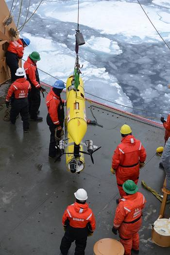 File Coast Guard Cutter Healy deckhands prepare to lower an unmanned underwater vehicle, operated by the Woods Hole Oceanographic Institute, into the Beaufort Sea. WHOI scientists used the UUV to monitor ice conditions from below during the simulated exercise. (U.S. Coast Guard photo by Petty Officer 3rd Class Grant DeVuyst)