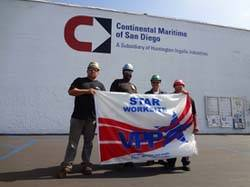 "File CMSD employees (left to right) Antonio Larrios Jr., Leander Hill, Robert Cooley and Anita Garcia display the VPP flag that was presented when the work site was awarded ""star"" status by OSHA."