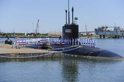 File Sailors assigned to the Virginia-class attack submarine USS Mississippi (SSN 782) man the ship during the commissioning ceremony for the Navy