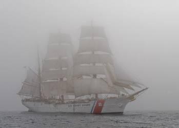 File The Coast Guard Cutter Eagle sails through dense fog. U.S. Coast Guard photo by Petty Officer 2nd Class Erik Swanson.