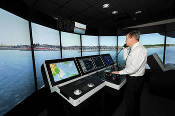 File Capt. John Kessler, maritime instructor, demonstrates how mariners train using the bridge simulators at the San Jacinto College maritime program. Photo credit: Jeannie Peng-Armao, San Jacinto College