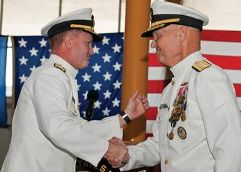 File Rear Adm. T. K. Shannon (left) and Rear Adm. Mark Buzby congratulate each other during a change of command ceremony aboard the USNS Spearhead (JSHV 1). Shannon relieved Buzby as commander, Military Sealift Command.  (U.S. Navy Photo by Mass Communication Specialist Seaman Apprentice Jesse A. Hyatt)