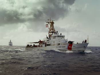 File USCG Cutter Sapelo and the Royal Netherlands Navy Offshore Patrol Vessel HNLMS Holland search Caribbean Sea waters for bales of contraband jettisoned by Dominican drug smugglers.