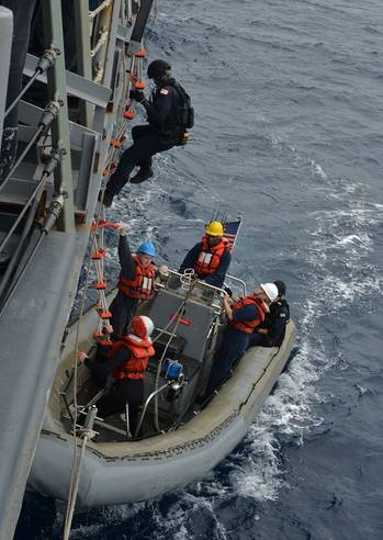 File Sailors assigned to the U.S. Coast Guard Law Enforcement Detachment Team 101 embark onto a rigid-hull inflatable boat during small boat operations aboard the guided-missile frigate USS Gary (FFG 51). Joint interagency and international relationships strengthen U.S. Third Fleet