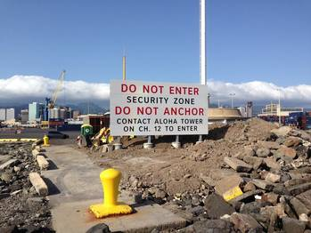 File The new sign in Honolulu Harbor will inform mariners of the 24/7 security zone in the harbor and whom to contact for permission to enter. (U.S. Coast Guard photo)