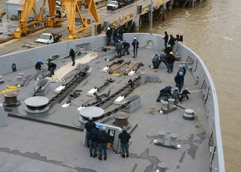 File Sailors on board Pre-commissioning Unit Somerset bring in all lines during sea and anchor detail on Somerset