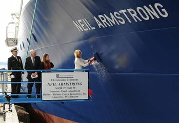 File Carol Armstrong, sponsor for the R/V Neil Armstrong , breaks a bottle across bow during a christening ceremony at Dakota Creek Industries, Inc., shipyard in Anacortes, Wash. Joining Carol on the platform are Rear Adm. Matthew Klunder, left, chief of naval research, Dick Nelson, president, Dakota Creek Industries, Inc., and Kali Armstrong, granddaughter of the late astronaut. (U.S. Navy photo by John F. Williams)
