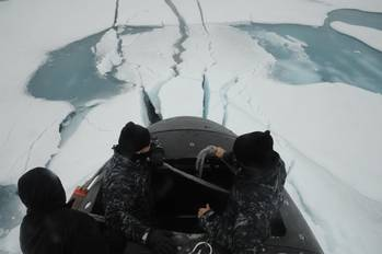 File Sailors aboard the fast attack submarine USS Seawolf (SSN 21) inspect the boat after surfacing through Arctic ice. Seawolf conducted routine Arctic operations. (U.S. Navy photo/Released)